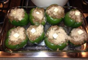 eight stuffed bell peppers ready for the oven