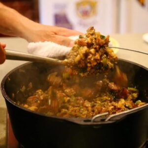 Mixing up jambalaya in a dutch oven