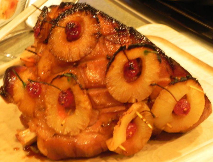smoked ham with pineapple slices and cherry garnish
