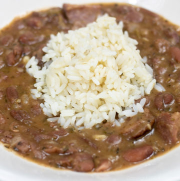 red beans with rice in a white bowl