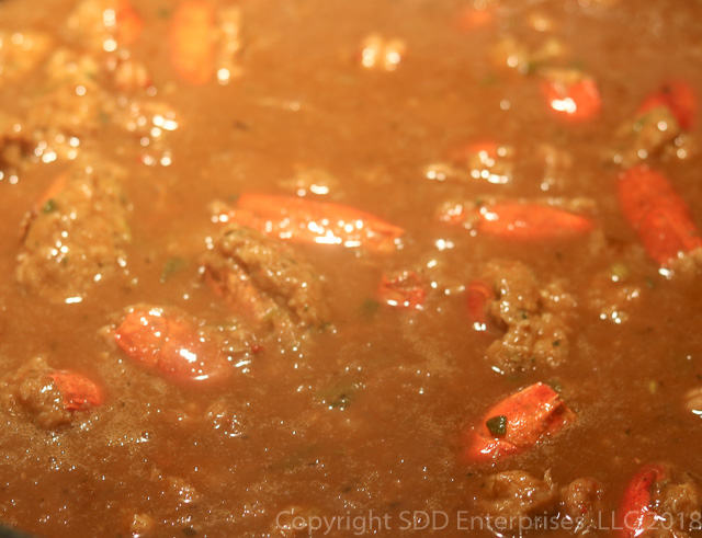 stuffed crawfish heads simmering in the bisque