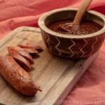 Cranberry BBQ Sauce in Bowl with Ladle and Andouille Sausage