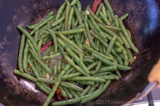 Sauteed Green Beans with Chile Peppers in a Wok