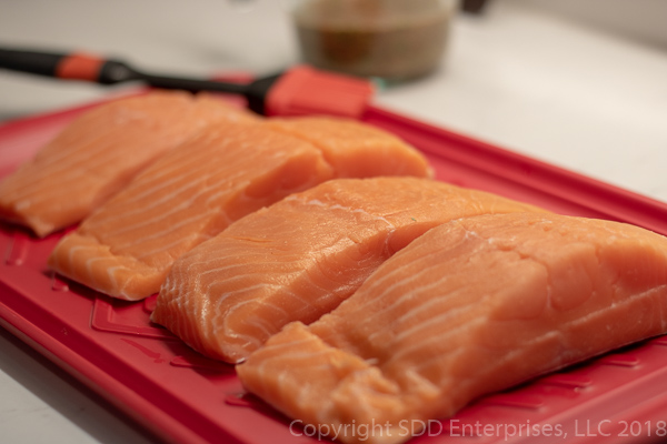 Fresh salmon filets in 6 ounce slices