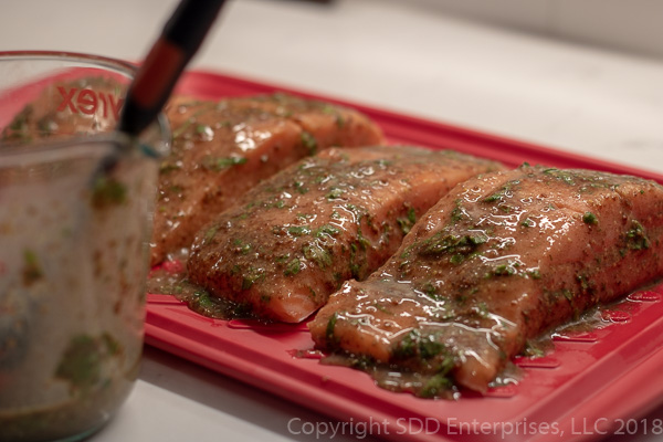 Marinating salmon with cilantro-creole mustard