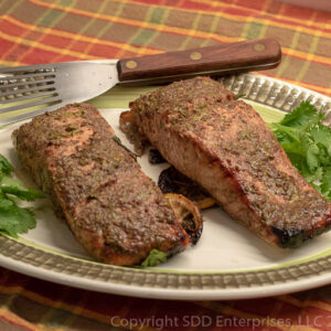 Grilled Cilantro-Creole Mustard Marinaded Salmon on a platter