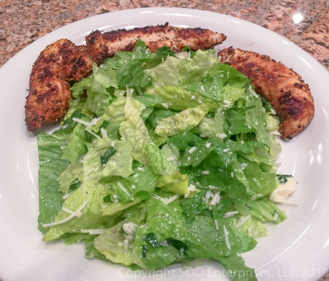 Sensation Salad with Grilled Chicken on a white plate