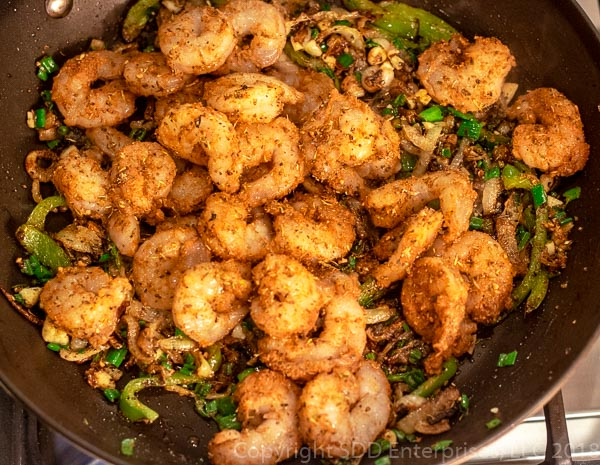 Sauteed shrimp with onions and peppers and spices