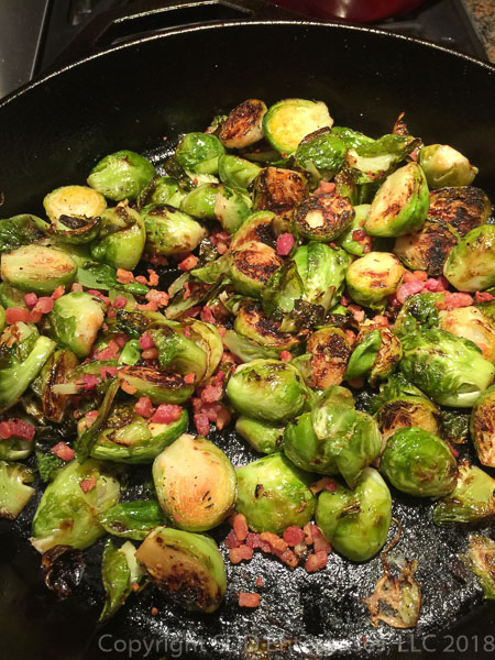 Roasted Brussels Sprouts with Pancetta in a cast iron skillet