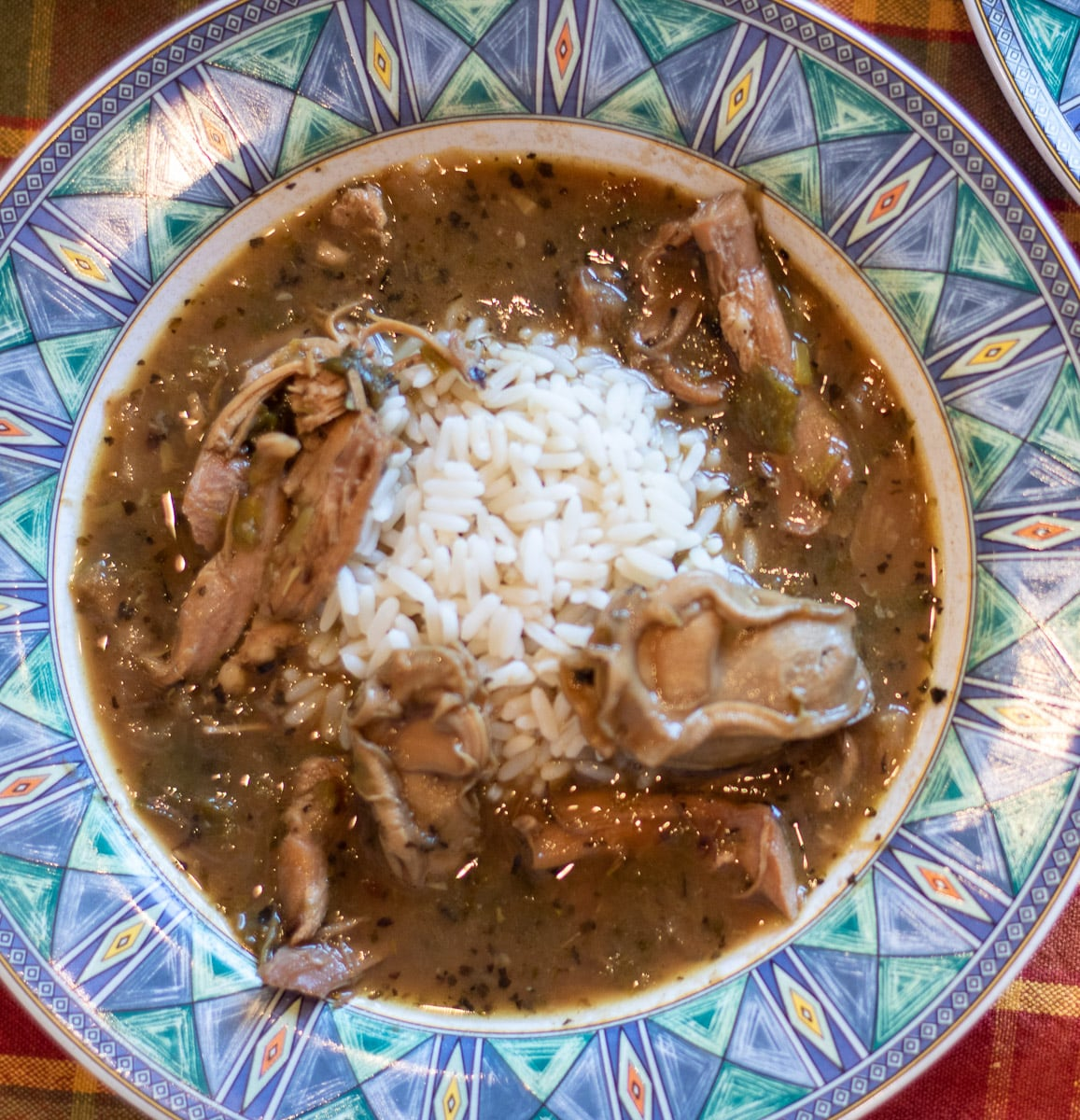 turkey oyster gumbo in a bowl with white rice
