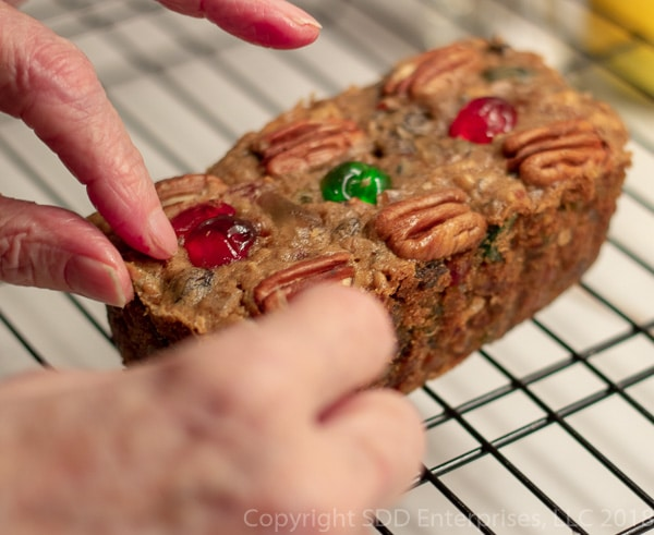 Putting the finishing touches on a fruit cake