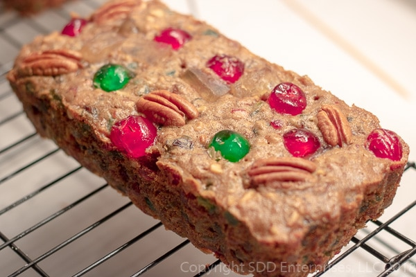 Fruit cake on a cooling rack