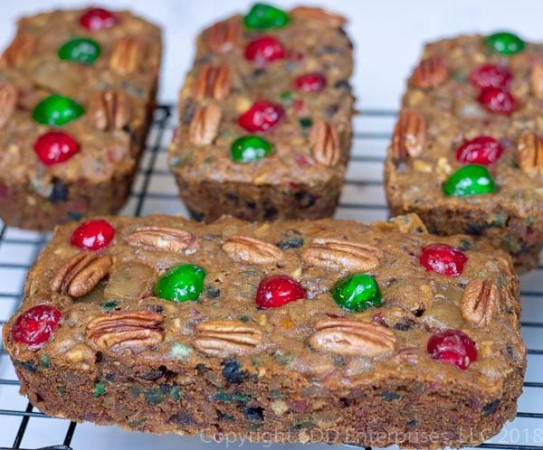 Four fruit cakes on a cooling rack
