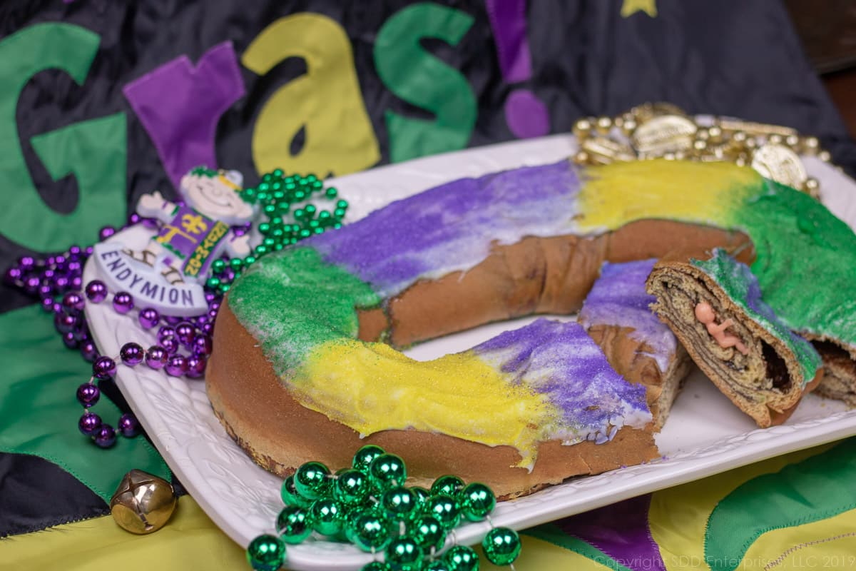 Baby in a sliced King Cake