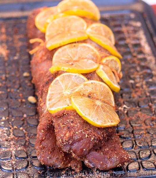 Pork tenderloin rubbed and tied with Meyer lemon slices