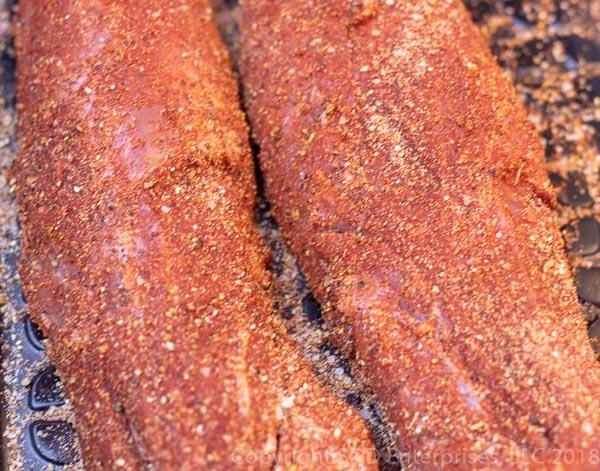 two pork tenderloins with dry rub