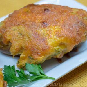 cajun twice baked potato with parsley garnish on a white dish