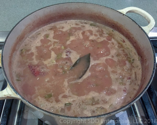 red beans and rice simmering in a dutch oven