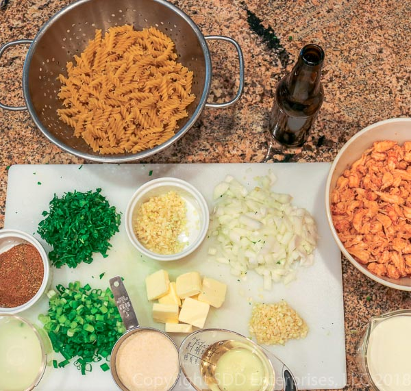 ingredients for crawfish monica laid out on a counter