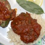 creole sauce served over rice with stuffed pepper and lemon and bay leaf