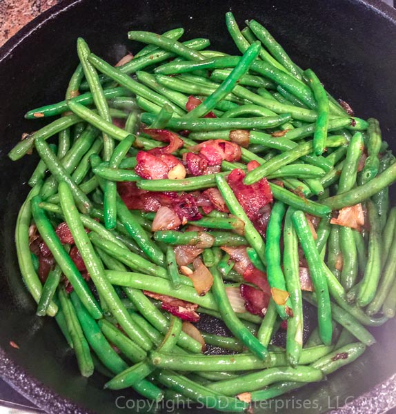 green beans added to the bacon and onions in dutch oven