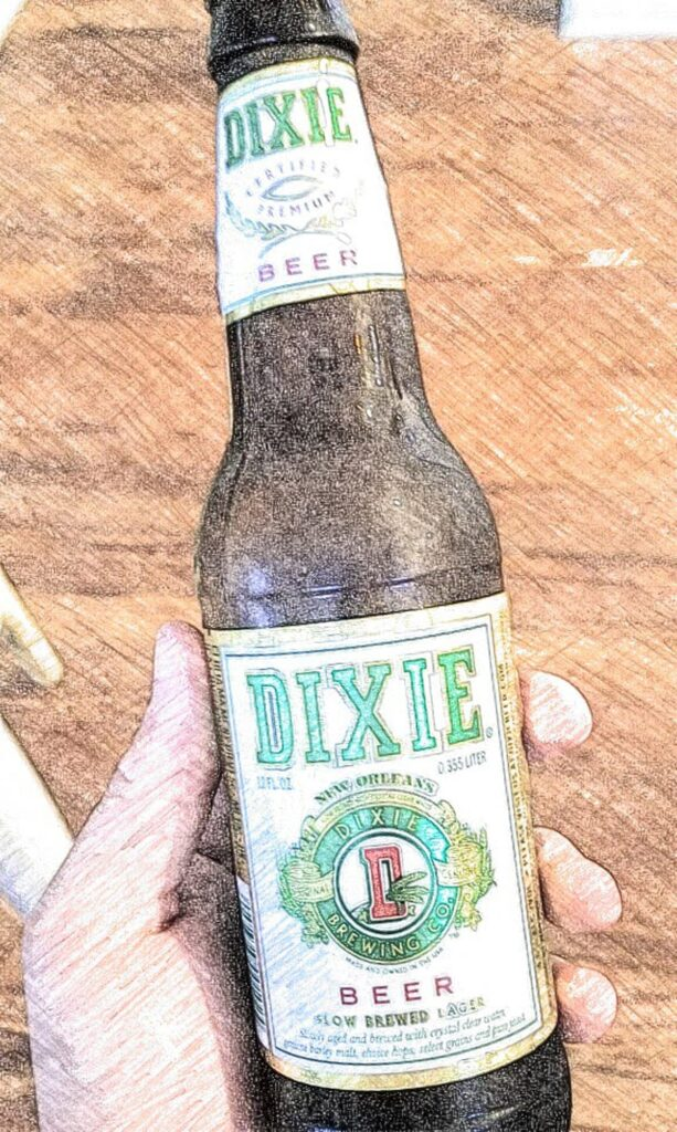 a bottle of Dixie beer held in a hand