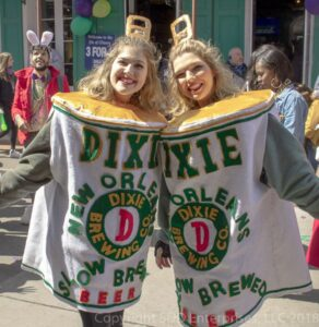 two mardi gras revelers dressed asdixie beer cans