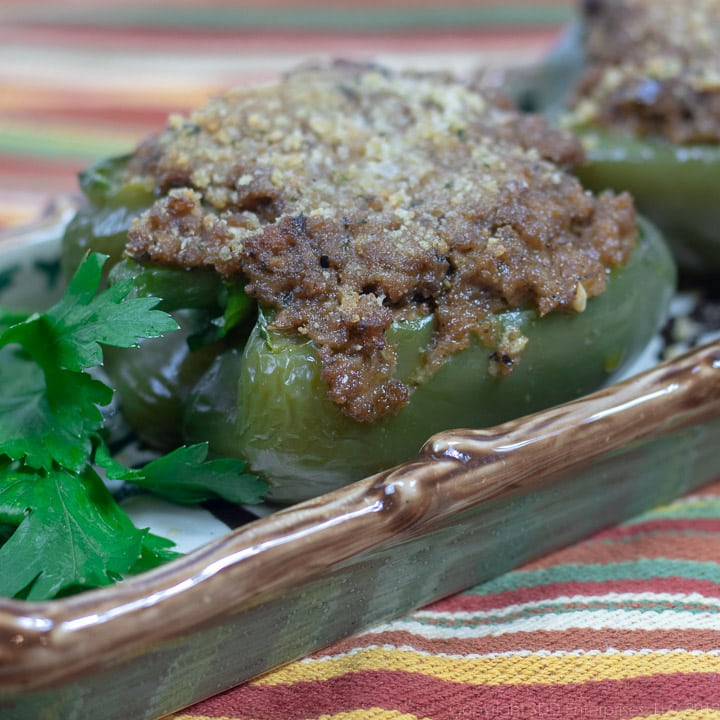 stuffed bell peppers on a platter with parsley garnish