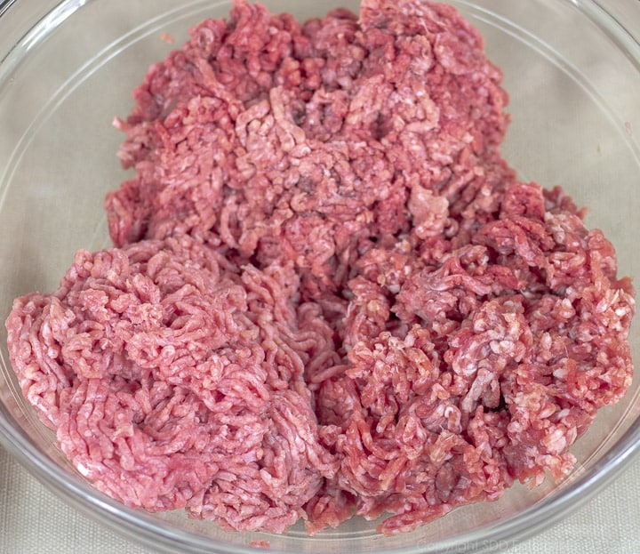 ground beef, veal and pork in a clear bowl