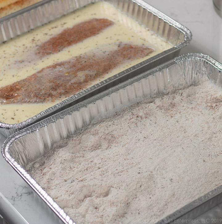 fish filets in egg-milk mix