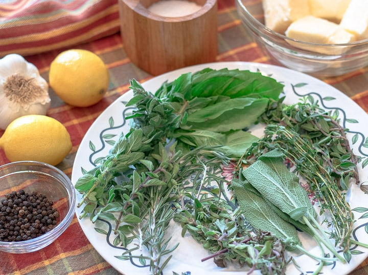 fresh herbs and ingredients for herb butter paste