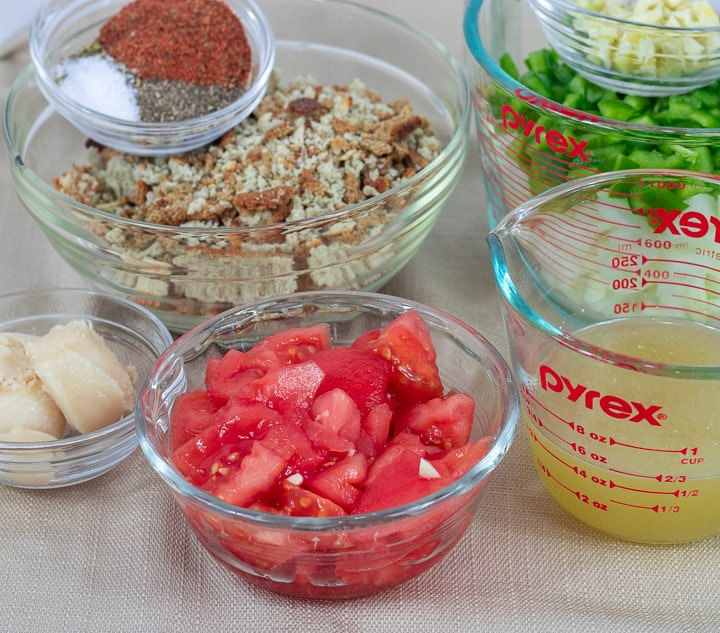ingredients for mirliton hrimp dressing in glass bowls