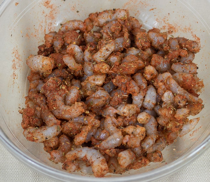 chopped shrimp with creole seasonings in a glass bowl