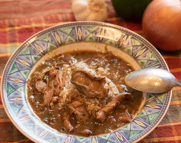 turkey oyster gumbo with rice with a spoon in a bowl