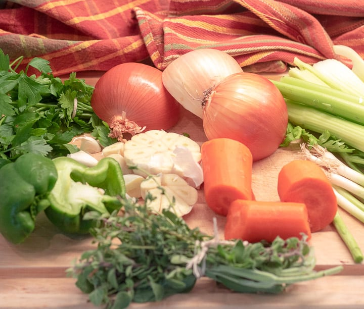 onions, carrots, celery, peppers, garlic and herbs for turkey stock