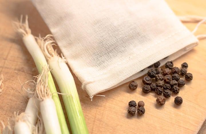 black peppercorns in a garni-bag