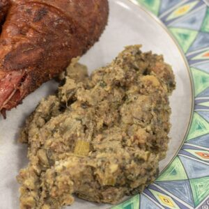 oyster dressing on a plate with a turkey leg