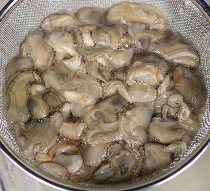 raw oysters in a colander
