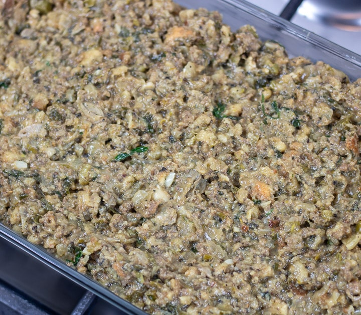 oyster dressing in a glass baking dish before baking