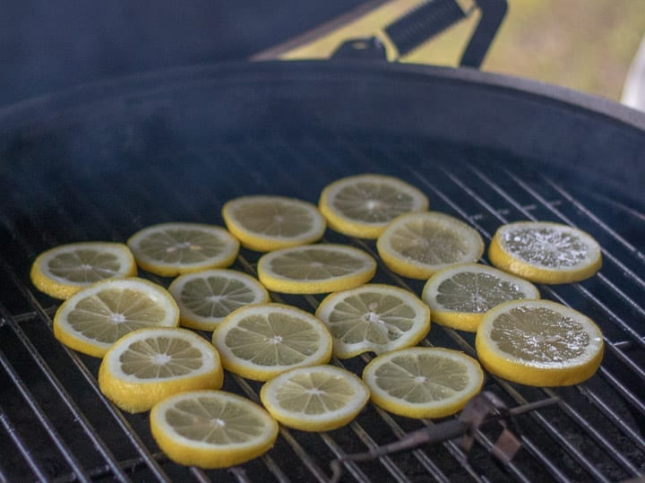 lemon slices placed directly on a hot grill
