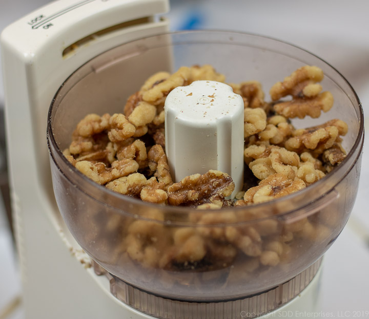walnuts and pecans in a small food chopper