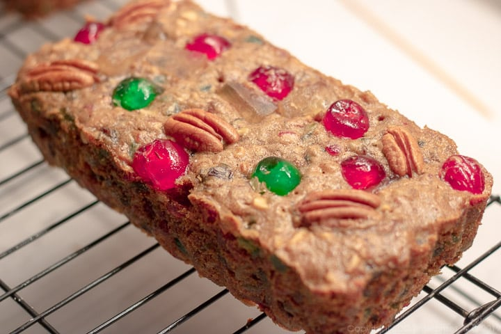 a small baked fruitcake on a cooling racj