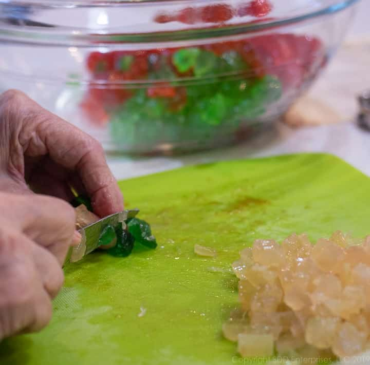 chopping candied fruit and placing them in a bowl