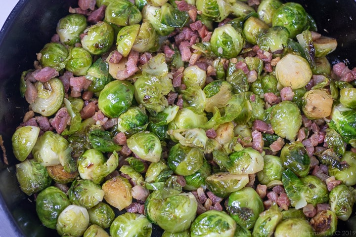 roasted brussels sprouts with pancetta in a cast iron frying pan