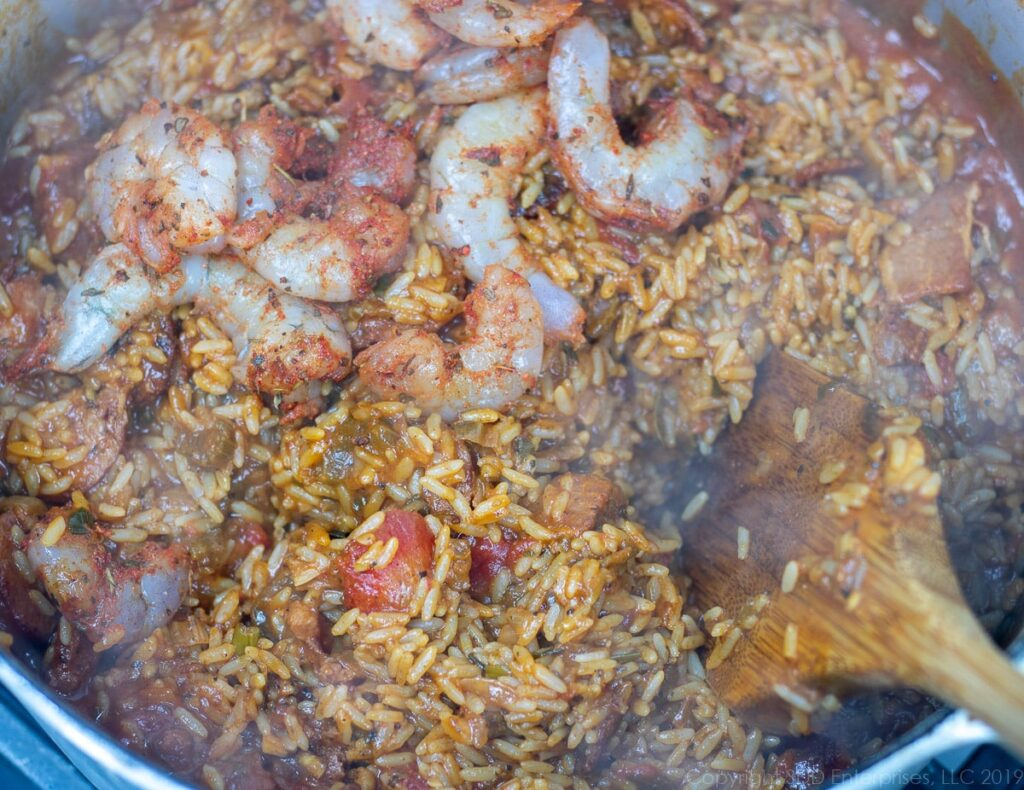 peeled and seasoned shrimp added to the creole jambalaya in a dutch oven