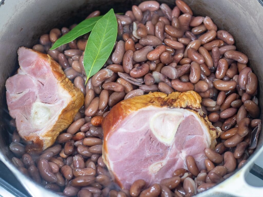 red beans, seasoning meats and bay leaves added to the sausage fat
