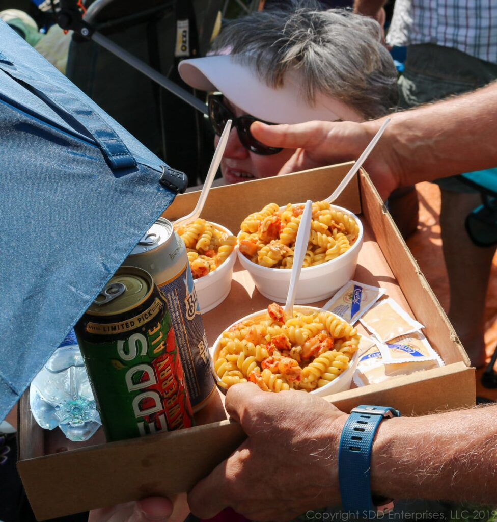 bowls of crawfish monica at the New Orelan Jazz Festival on a tray