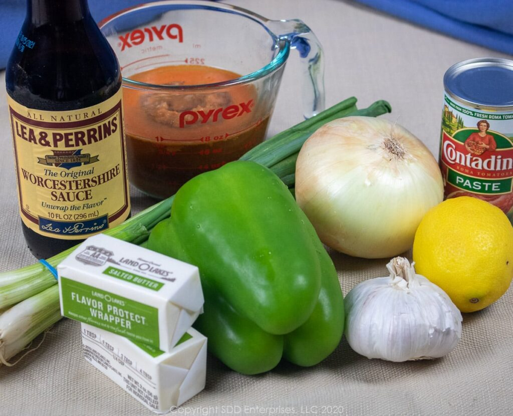 yellow and green onions, garlic, bell pepper, lemon, stock, worchestershire and tomato paste for shrimp and grits