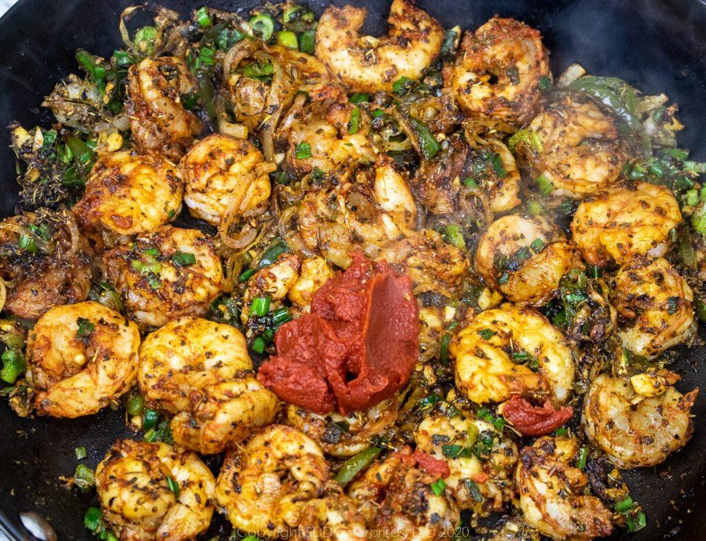 tomato paste added to sauteed shrimp