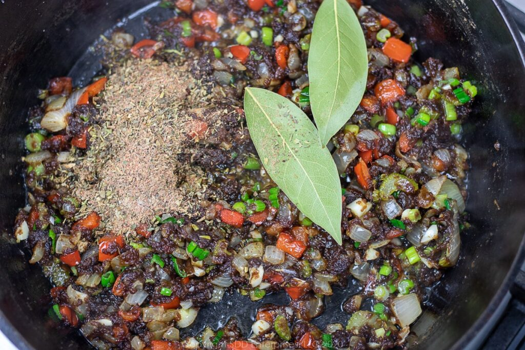 herbs and spices with bay leaves added to the roux and vegetables